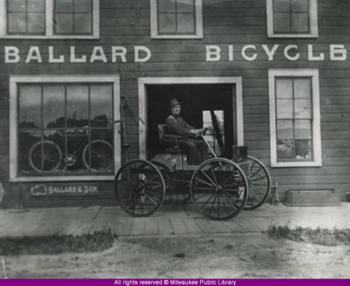 Man on horseless carriage Ballard Bicycle Milwaukee Wisconsin