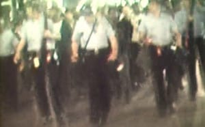 Frame from news film clip of fair housing march, likely the night of August 29, 1967.