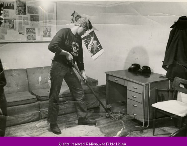 NAACP Youth Council member Forthune Humphrey Jr. mops room, Milwaukee, 1966.