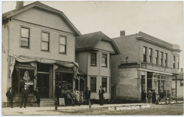 Postcard of post office and tailoring shop in Middleton, Wisconsin, 1909.