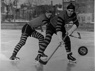 Two hockey players at Marquette University, Milwaukee, 1920-1929. Marquette University Archives.