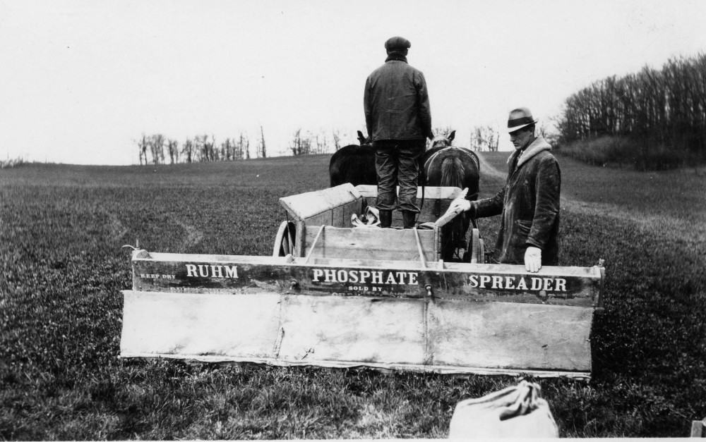 Phosphate spreader pulled by a team of horses.  Cornfalfa Farms collection, New Berlin Historical Society.