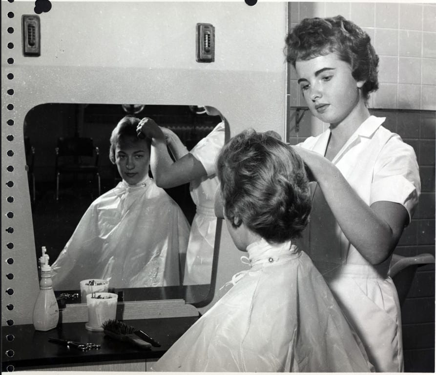 Cosmetology student works on a client at Milwaukee Area Technical College, 1960-1965.