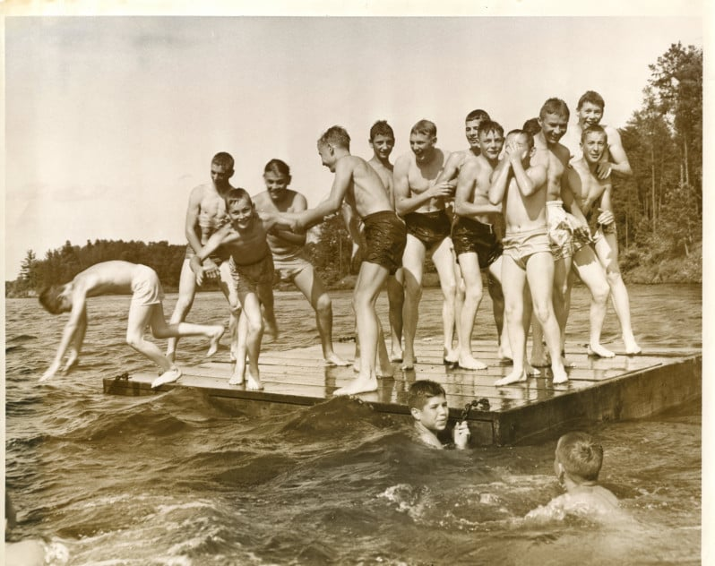Boys swimming on a raft in a lake, Wisconsin Rapids, ca. 1950.