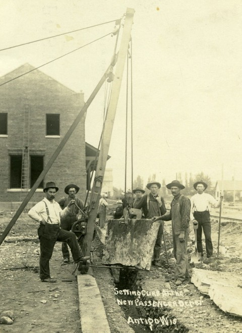 Setting curb at the new passenger depot, Antigo, 1907. Langlade County Historical Society.