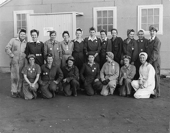 Female employees of Globe Shipbuilding Company in kerchiefs and coveralls, Superior, ca. 1942.  Great Lakes Maritime History Project, Jim Dan Hill Library, UW-Superior.