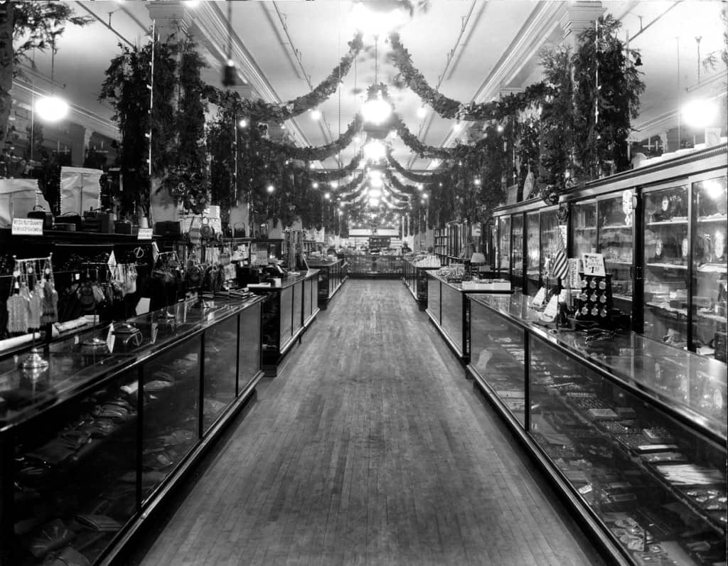 Wide aisles, high ceilings, and glass show cases such as these at Lauermans of Marinette were common in the glory days of the department store. This is the jewelry and accessories department of Lauermans, circa 1920. A marble floor was added in 1935. Author's collection.