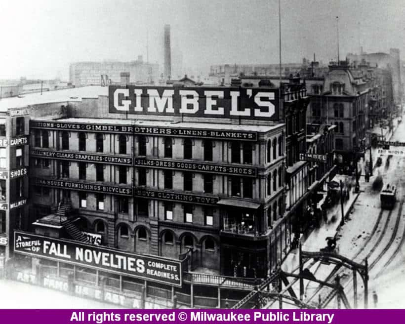 The Gimbels building, on the Milwaukee River at Wisconsin Avenue in downtown Milwaukee.  Gimbels got its start as a trading post in Indiana before taking up business in Milwaukee in 1887. It expanded its operation to Philadelphia in 1894, then to New York in 1910, where by the mid-1920's it was firmly entrenched in a rivalry with Macy's. Milwaukee Public Library.