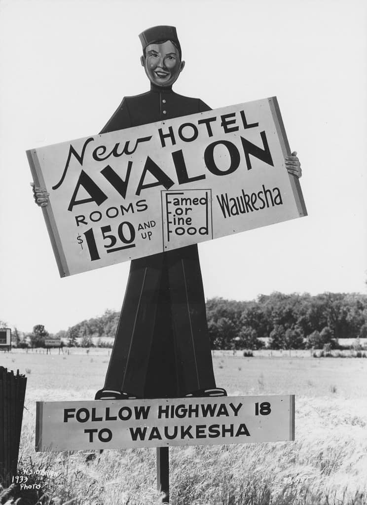 This 1933 billboard for the new Avalon Hotel in Waukesha advertises room rates starting at $1.50.
