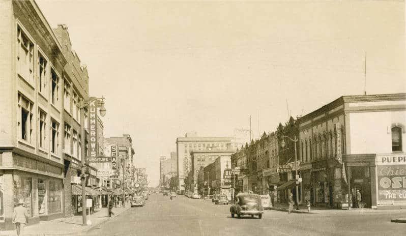 This view of Oshkosh's Main Street looking north in 1946 shows a bustling downtown shopping district, including Sears and Kline's Department Store. Oshkosh Public Library.