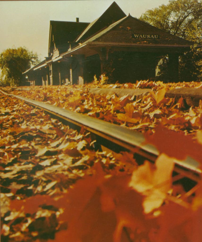 This view of the Wausau railroad depot in autumn was an advertising photograph for the Wausau Insurance Company, 1980-1999. Marathon County Historical Society.