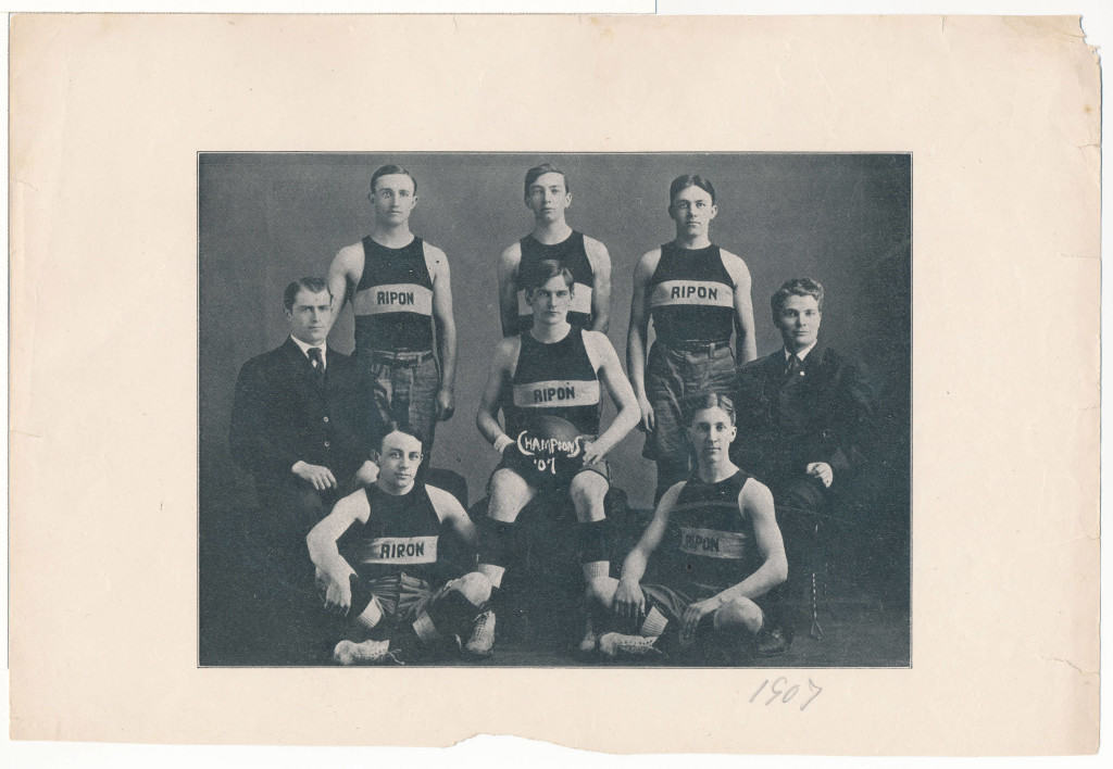 The earliest image in the digital collection: the Ripon College men's basketball team, with two coaches, in 1907. Ripon College Archives.