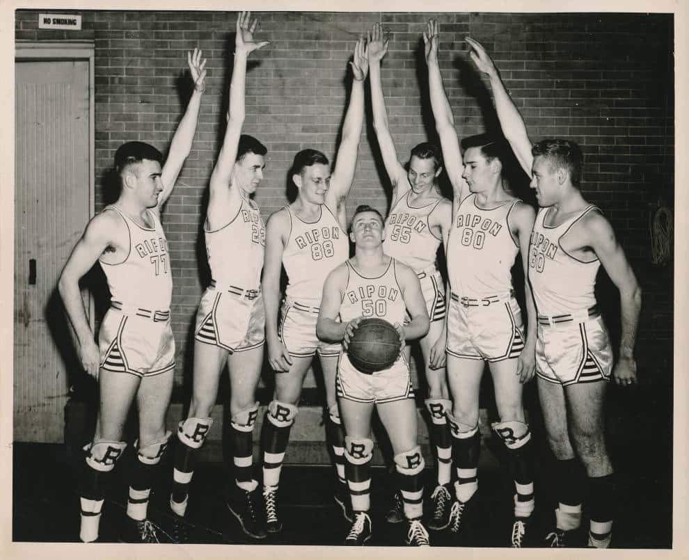 Don Stevens, center, surrounded by the taller members of the Ripon College basketball team, 1946. Ripon College Archives.