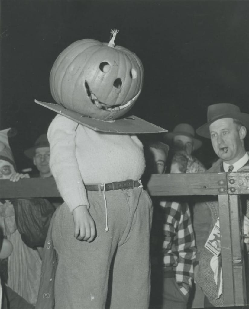 Boy in pumpkin head costume, Milwaukee, 1949. Milwaukee Public Library.