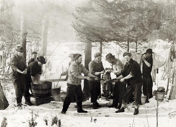 Sunday washing at Rice Lake Lumbering Camp #6, ca. 1913. Wisconsin Historical Images WHi-24425.