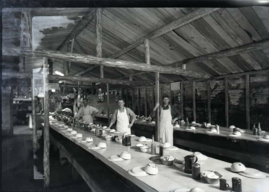 Tables set in the mess hall before loggers descend. Photo by Arthur J. Kingsbury. Langlade County Historical Society.