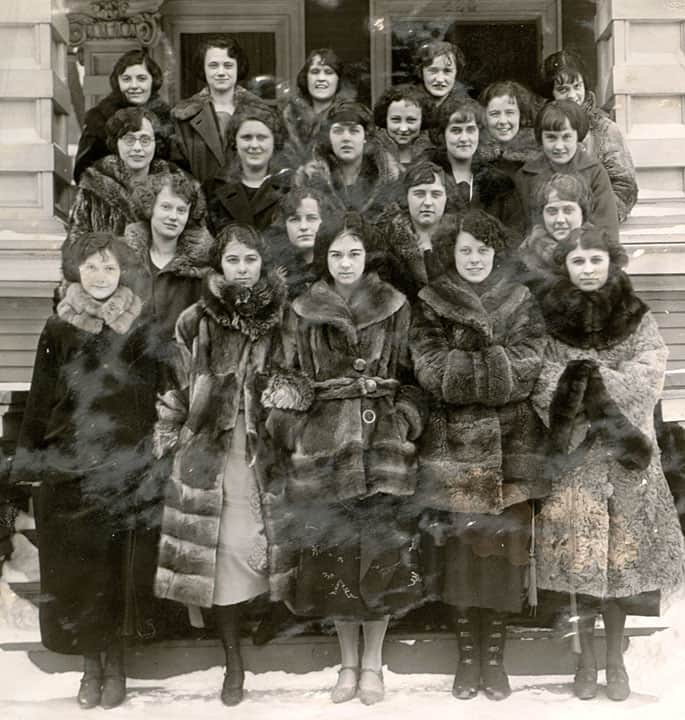 Members of the Sigma Kappa sorority keep warm in stylish fur coats, December 1922. UW-Madison Archives by way of University of Wisconsin Digital Collections.