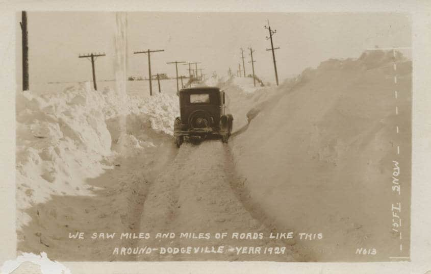 """We saw miles and miles of roads like this around Dodgeville."" The caption along the right edge of this postcard notes a 15-foot snowdrift. Iowa County Historical Society."