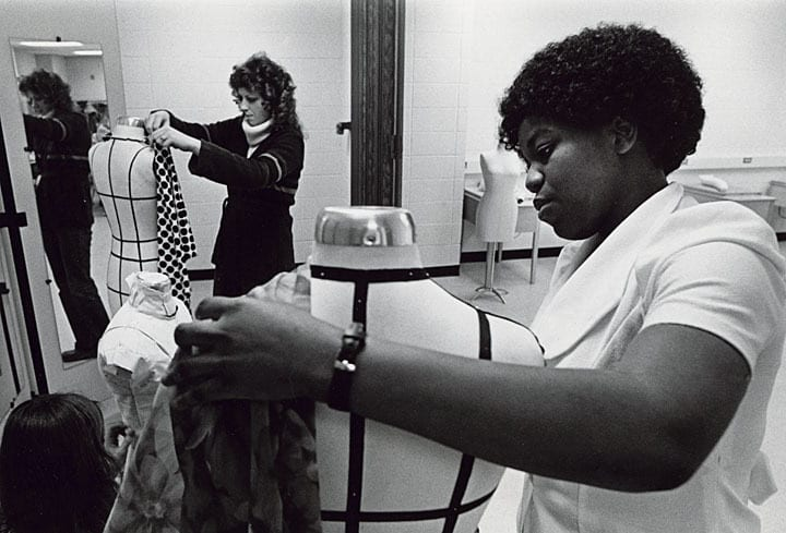 Students work with fabric and dress forms in a clothing construction class, 1979. University of Wisconsin-Stout.