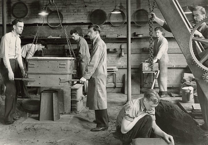 Students working in the molding room of the metals foundry, ca. 1930. University of Wisconsin-Stout.
