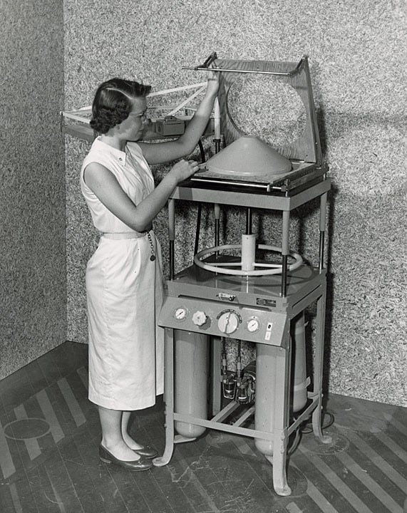 A student uses a press patented by Robert S. Swanson to create a plastic lampshade, ca. 1958. Swanson began his career at Stout as a student, became a faculty member in Applied Science, and served as the school's Chancellor during the 1970s and 80s. University of Wisconsin-Stout.