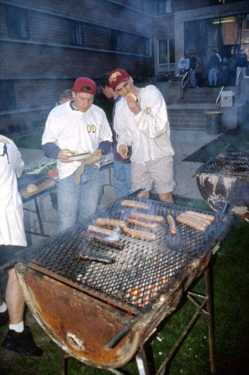 Grilling brats outside O'Donnell Hall, Marquette University, 1994. Building a Campus, Department of Special Collections and University Archives, Marquette University Libraries.