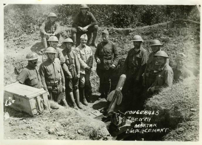Soldiers pose with a mortar in a trench in the Brittany region of France. Langlade County Historical Society.