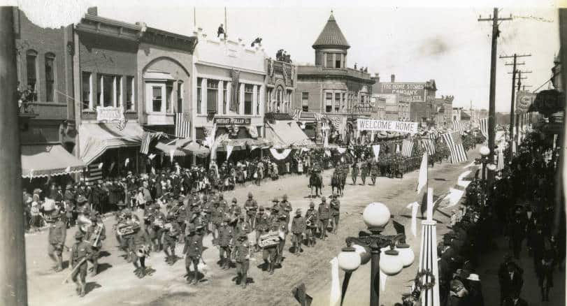 Antigo welcomed the 107th TMB back home with a parade down Fifth Avenue on May 17, 1919. Langlade County Historical Society.