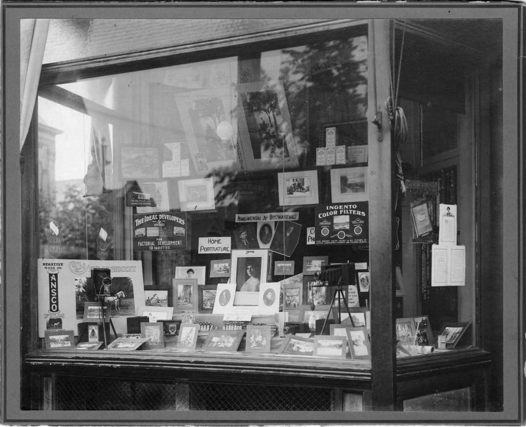 Display window at Kwasniewski's photography studio on Lincoln Avenue, Milwaukee. University of Wisconsin-Milwaukee Libraries.