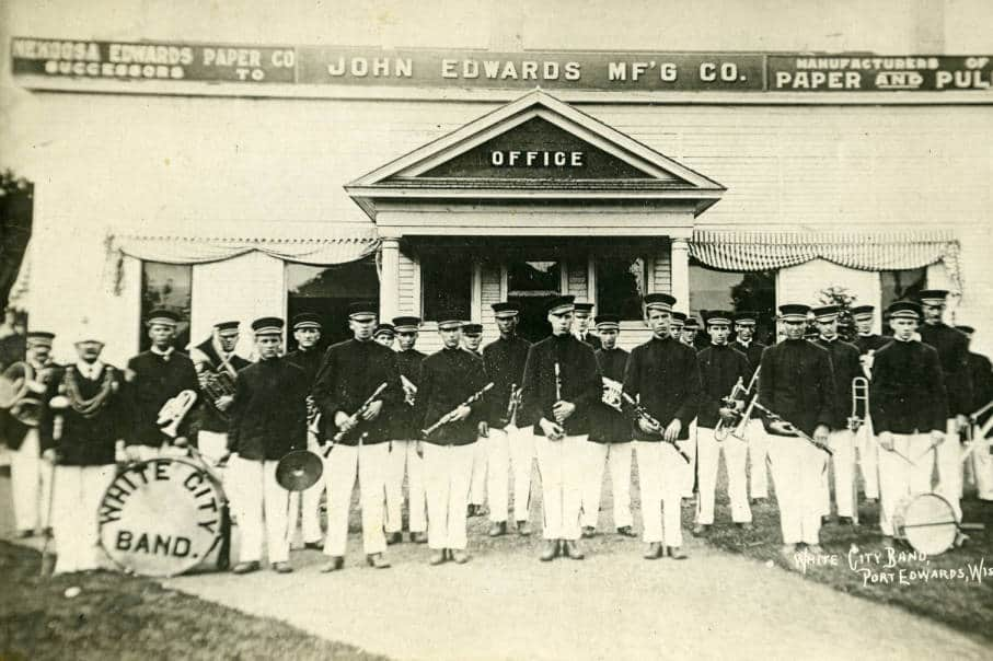 The White City Band posed in front of the main office of the Nekoosa Edwards Paper Company, Port Edwards, ca. 1910. South Wood County Historical Museum.