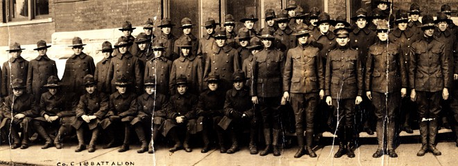 Members of the Students' Army Training Corps (S.A.T.C.) Battalion Company C pose for a group photo, probably on the day of their decommissioning, December 18, 1918. Marquette University Archives.
