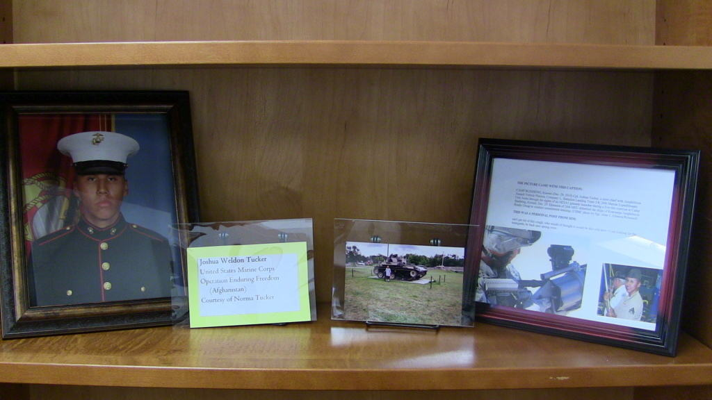 Photographs of Joshua Weldon Tucker on exhibit in the library.