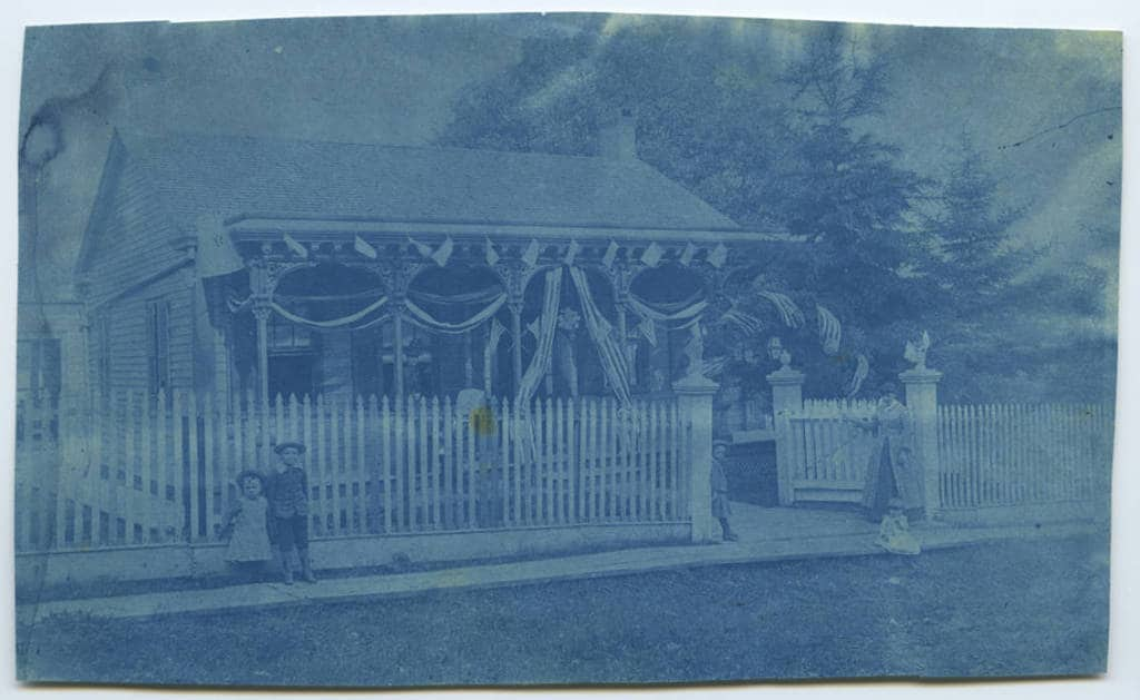 Cyanotype of 510 Church street, decorated with flags and bunting. Mineral Point Library Archives.