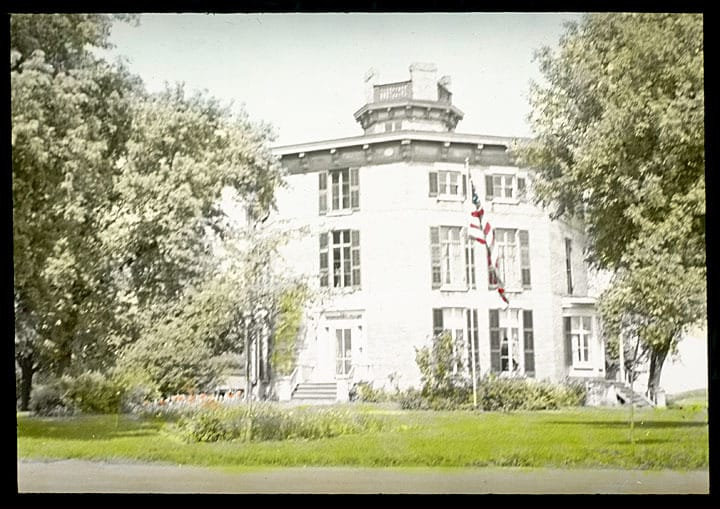 Octagon house in Watertown, constructed in 1853. This image, a colored glass lantern slide, dates to 1938. C. E. Dewey Lantern Slide Collection, Kenosha History Center.