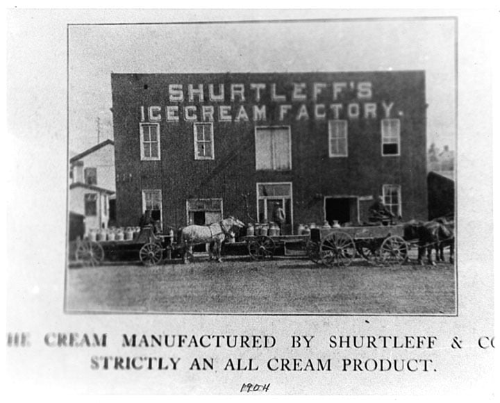 Shurtleff's Ice Cream Factory, established in Janesville in 1878. This photo shows horses bringing milk cans to the factory in 1904. In 1969, George Shurtleff sold his ice cream business to Schoep's Ice Cream in Madison. Hedberg Public Library.