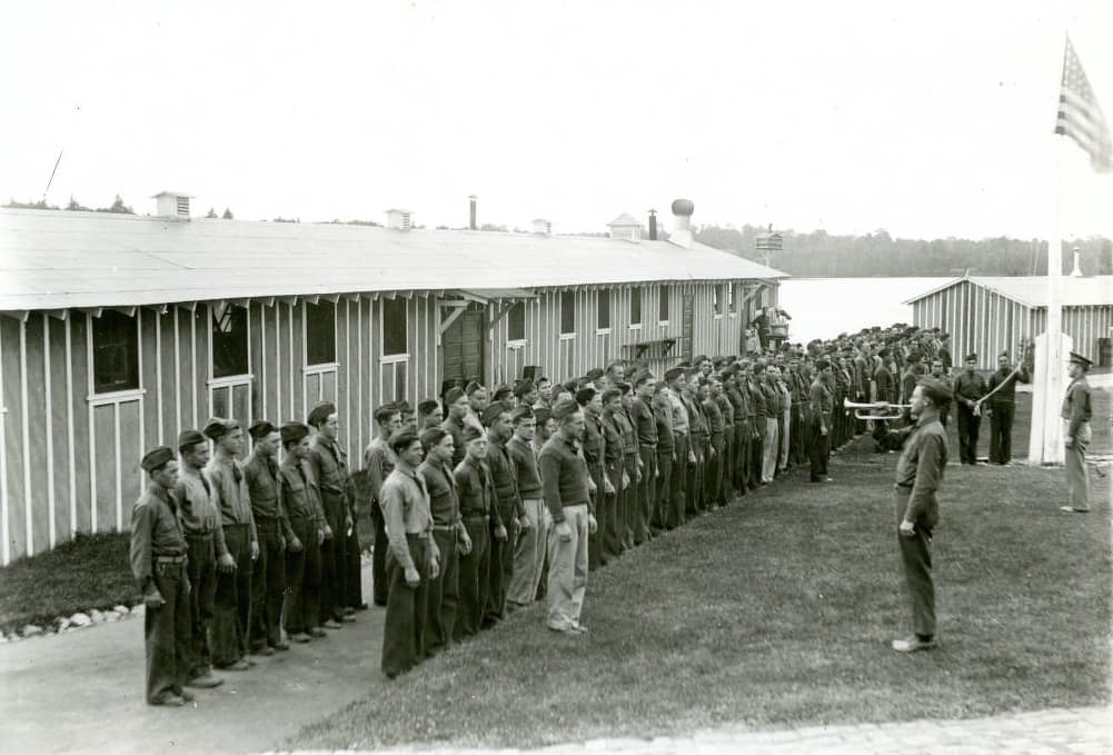 Morning reveille at Camp 657. CCC camps operated like the military, with U.S. Army officers in command under the aegis of the Departments of Labor, Interior, and Agriculture. Photo by Warren Schabell. Langlade County Historical Society.