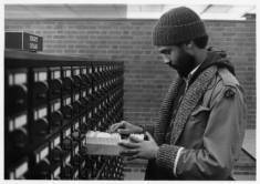 Student_searching_subject_card_catalog_at_UWM_Libraries