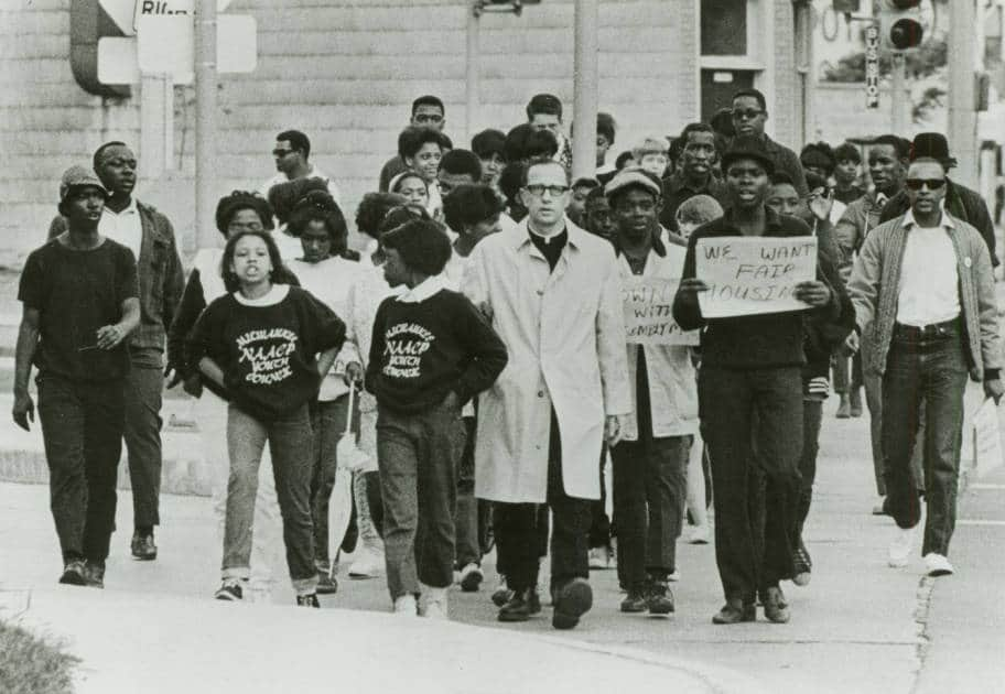 Father James Groppi and members of the NAACP Youth Council march in support of Vel Phillips' Open Housing bill, 1967. Milwaukee Public Library.