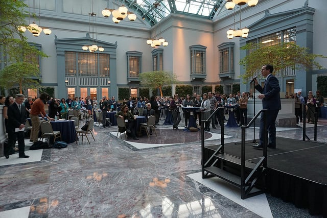 Outgoing DPLA executive director Dan Cohen addresses attendees in the Winter Garden.