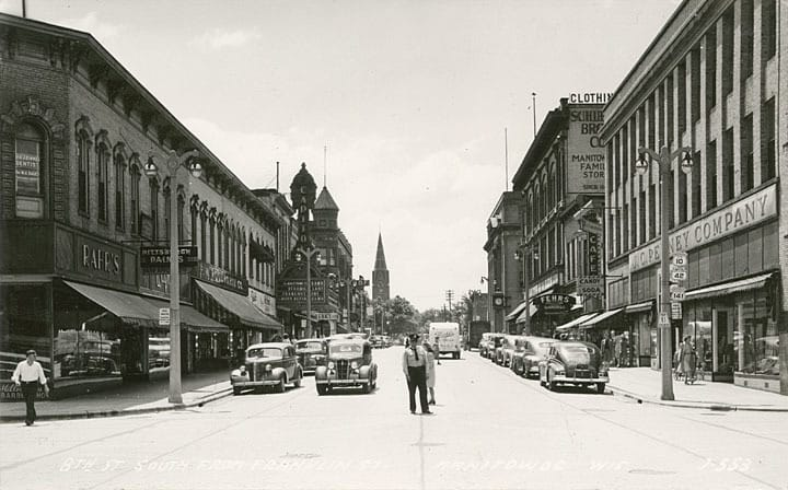 Schuette Brothers Department Store at 914 S. Eighth Street in Manitowoc closed its doors in 1994 after 145 years of business. This photo, looking south from the corner of S. 8th and Franklin streets, shows Woolworth's on the left, J. C. Penney on the right, and Schuette's in the distance on the right. The Schuette's building stands empty today.  Manitowoc County Historical Society.