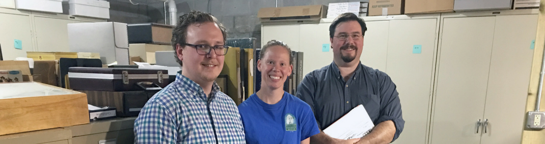 Cameron Fontaine, Amy Meyer and mentor Pete Shrake (Circus World Museum) in collections storage at the Manitowoc County Historical Society.