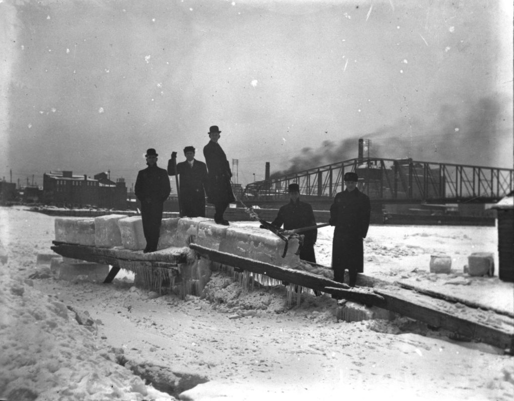The frozen La Crosse waterfront with five men harvesting ice, ca. 1913. UW-La Crosse Murphy Library via University of Wisconsin Digital Collections Center.
