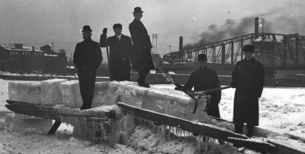The frozen La Crosse waterfront with five men harvesting ice, ca. 1913.